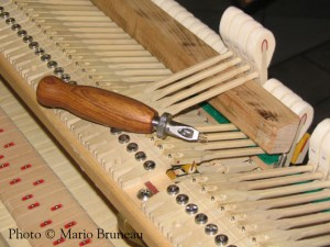 Grand piano action, voicing the hammers